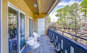 The Dagny's spacious balcony with chairs and storage closet.